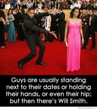 Guys are usually standing next to their dates or holding their hands, or even their hip; but then there's Will Smith.