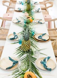When Amber says her baby shower was 'a dream' we couldn't agree more! We are vicariously living through her bright papaya & palm leaves tropical baby shower