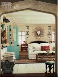 Gorgeous Interior - I love the arch and the punch of turquoise with the door paint