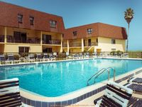 Beautiful 1st floor Cocoa Beach Poolside Condo - Complex is On the Beach. Features three (3) bedrooms, plus queen-sized sofa bed, and two (2) bathrooms (sleeps eight) max. occupancy is 8. The condo is in the courtyard, end unit, cl...