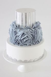 beautiful dusty blue rose wedding cake