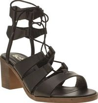 Schuh Black Pixie Womens Low Heels Get ready to tick multiple trends off your new season shoes list, with the Pixie from schuh. Arriving in black faux-leather, the strappy lace-up silhouette sits on a wooden-effect 7cm block heel. A ru http://www.compares...