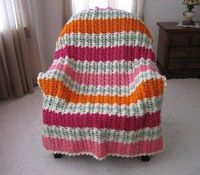 This Merry Melon Afghan is a lovely and fun way to liven up your home. Made with an offset shell stitch, this unique crocheted afghan has a neat zig zag look th