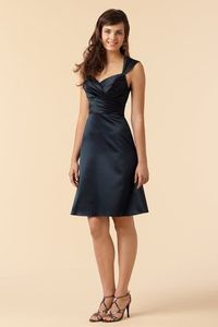 I really like the cut and color of this dress. I wish it were below the knee though.