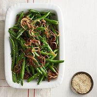 It only takes a few ingredients to liven up green beans by adding a delicious sesame-ginger dressing.