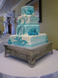teal wedding cake, maybe in purple or platinum for ours...