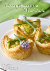 A quick and easy Cheesy Guacamole Mini Quiche Recipe using puff pastry and Wholly Guacamole. The smooth creamy avocado essence makes these little bites really s