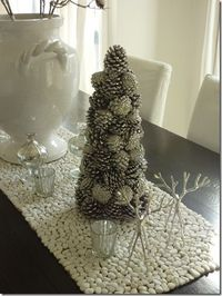 Dress up the table with a white pebble table runner. More on www.easyDIY.co.za