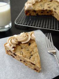 Thick and Chewy Oatmeal Raisin Cookie Cake with Cinnamon Maple Icing