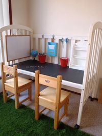 Turn an old crib into a work bench for the little ones. Love the chalkboard surface!