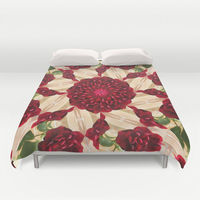 Duvet cover with a kaleidoscope pattern of a red rose flower