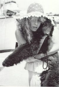 Stevie Nicks and her black standard poodle