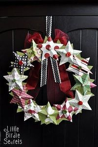 Make a Christmas Wreath   Want to make a Christmas wreath this year? Simple paper stars with glue and extras are one easy way to decorate your door.