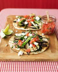 Make these tostadas on the grill, in the summer, when produce is most flavorful and everyone will enjoy them to the fullest.