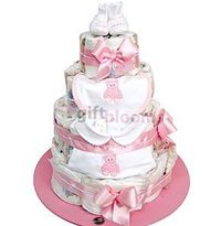 4 Tier Baby Diaper Cake: 84 Huggies Natural Care size P, Body, Bib, and baby boots 100% cotton. Approximate Dimensions: 12'�'�W x 14'�'�H