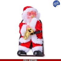 "Cute Christmas theme Singing Santa Claus electric toy, a Santa Claus with a Saxophone siting on a rocking chair. It plays '�'��""Jingle bells'�'� with moving rocking chair, head and saxophone and amazing light effect.