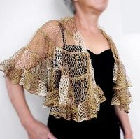 This shawl is similar to the Kelp Forest Shawlette but it is a half-circle, not a circle. Starting from the neck, the rows are made by crocheting the thin edge into the wide edge. The tricky part is turning at the end of each row. To do this, fold the yar...