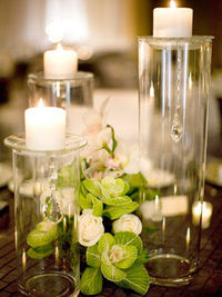 small flowers raised candles