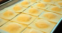 Butternut Squash Ravioli Serves 8-12 1 pound butternut squash, cooked 1 pound ricotta cheese, whole or part skim 1/2 cup Parmigiano Reggiano cheese, grated 1/2 teaspoon salt 1/2 teaspoon pepper 1/2 teaspoon nutmeg 96 egg roll wrappers (2 packages of s...