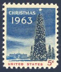 United States 1963 Christmas Stamp - this second United States Christmas stamp was based on an on-the-spot painting made by artist Lily Spandorf of President John F. Kennedy lighting the National Christmas tree. The National Christmas tree and the White H...