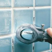 Replace grungy, eroded grout in your shower. Simplify the tough grout removal part with an inexpensive power grinder. It speeds up the job so you can move on th