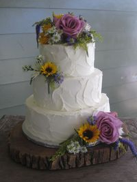 Love this wedding cake! But with our flowers, cake topper, and some raffia.