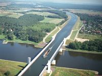 The Magdeburg Water Bridge ~ a navigable aqueduct in Germany, opened in October 2003, connecting the Elbe-Havel Canal to the Mittelland Canal, crossing over the Elbe River. Notable for being the longest navigable aqueduct in the world, with a total length...