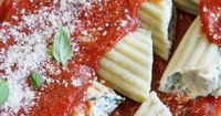 Amazing Manicotti is a delicious and hearty Italian pasta dish stuffed with 3 creamy cheeses, spinach, and fresh herbs. This can be made ahead & frozen too!