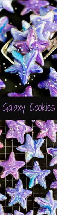 Star shaped galaxy cookies with a cosmically-inspired glaze. The recipe makes a dark chocolate shortbread style cookie and a simple vanilla glaze.