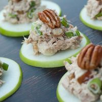 Thinly sliced apple with chicken salad and a pecan garnish. YUM!