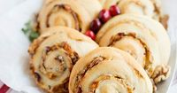 Cranberry Walnut Blue Cheese Pinwheels to serve at your holiday parties. Crescent dough filled with cream cheese, blue cheese, cranberries, and walnuts.