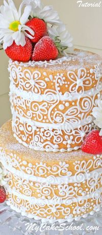A new twist on the naked cake! This elegant naked cake is dressed in delicate buttercream scrollwork. Learn to make it in our video tutorial!