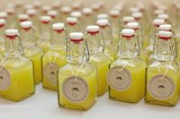 Homemade Limoncello (makes about 64 ounces) (Recipe adapted from Martha Stewart) 11 organic lemons 1 liter bottle vodka (Martha suggests 160-proof, I used 100)