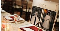 table numbers with photos of bride and groom at that age. creative and hilarious!