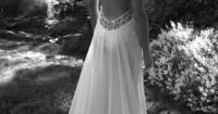 Not that I'm in the market for a wedding dress, or are really even into them--but this is really pretty