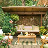 Add plants and an overhead structure to enclose your deck. More deck landscaping ideas: http://www.bhg.com/gardening/landscaping-projects/landscape-basics/deck-landscaping-ideas/