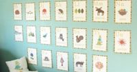 Super cute! We hung these cards in the nursery with twine and small wooden clothespins for a more natural look.