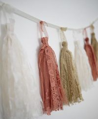 Easy fabric tassels/ gonna do this above Naomi's bed.