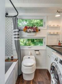 """A lot of tiny houses look a bit like little dollhouses on wheels�€""""peaked roof, petite double-hung windows, a tiny, almost vestigial porch"""