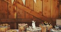 rustic wedding dessert bar from a barn wedding i love the upright deer wedding cake topper [even though it isnt on a wedding cake]