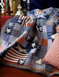 Cute patriotic quilt. I could use some of those old denim jeans and flannel shirts!.