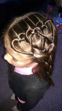 Heart braids. make a pony tail & tie w/ band, put hair back up through middle of pony tail, split hair into two sections, twist each section away from middle, bring together and tie with band - and it sits as a heart <3 (was easy to do one...to...
