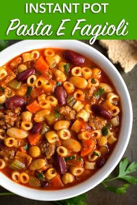 Instant Pot Pasta E Fagioli is a rustic and hearty Italian peasant soup. With sausage, beans, pasta, and tomato, it is a perfect Fall comfort food. simplyhappyfoodie.com #instantpotrecipes #pastaefagioli #instantpotpastaefagioli #fazool #instapotsoup