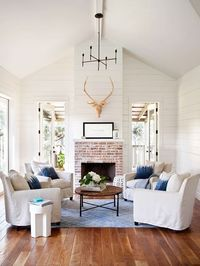 Love the grouping of chairs and plank walls