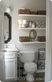 Some of these ideas are getting a bit wild, but here's a simple 3 shelf solution to clean looking bathroom storage.