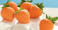 """Chocolate-Covered Strawberry """"Carrots"""" for Easter. {Use white chocolate with orange food coloring}"""
