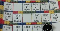 Here's a simple idea for using LEGO blocks to count. Students move around the board adding or subtracting blocks from their tower. At the end of the game, players count how many they have and the player with the most wins! (They can also compare t...