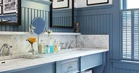 A savvy period-inspired remodel dramatically transformed this once-tiny bathroom, making it usable as a master bath. Thoughtful touches such as beaded-board paneling, exposed storage, and period fixtures fill the new bath with unbeatable charm.