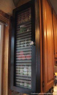 Organize your kitchen spices and save some cabinet space with an easy DIY custom spice cabinet. Great for beginning DIYers!