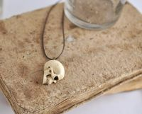 Unisex Skull necklace - Synthetic ivory skull on brown Waxed Polyester Cord $23.00